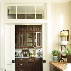 pocket doors and transom leading into the working butler's pantry - room enough in there for a lot of the prep work and mess; include a sink