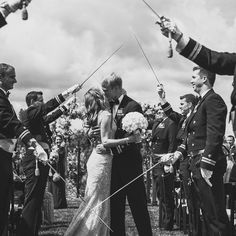 We're speechless....this image is too precious and perfect for words! Xoxo @weddingchicks #wedding #kiss #photography #love #swords #military
