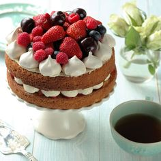 This classic victoria sponge cake is a recipe fit for a Queen. It combines some of Britain's most love dishes; from a soft vanilla victoria sponge, filled with fresh British strawberries, buttercream infused with the nations favourite drink – tea and topped with a Eton Mess style 'crown' of meringues and berries. A real royal showstopper.