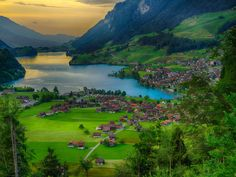 WENGEN, SWITZERLAND The charming mountain village of Wengen, Switzerland, is home to cozy timber houses and chalets where you can stay before trying out activities like paragliding, river rafting, or hiking along the area's stunning valleys and meadows.