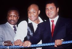 Former heavyweight champions Joe Frazier, George Foreman and Muhammad Ali, in London England, June 16, 2004. (Getty Images)