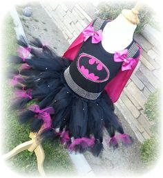 You are looking at a listing for a pretty pink batgirl. This listing includes the tutu, embellished top, and cape. This item takes 3-4 weeks to make. Please allow enough time. Convo with questions