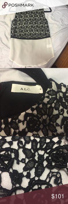 A.L.C. Silk with black lace flower pattern A.L.C. Silk with black lace flower pattern on half of the blouse A.L.C. Tops Blouses