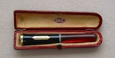 A very lovely vintage cigarette holder and case that Pip Crosby might have carried.