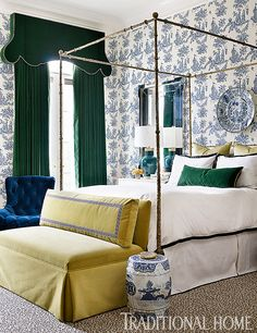 Emerald-velvet valances and draperies offer a textural, jewel-tone contrast to the classic toile in this bedroom. - Photo: Emily Jenkins Followill / Design: Melanie Turner
