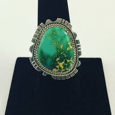 Stirring silver ring with a green turquoise stone....made by Michael Harvey