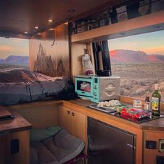 This is the most gorgeous #vanlife kitchen! Nice campervan views with outdoors and plenty of nature coming though the windows. I really wanna travel now!