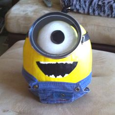 My Minion pumpkin!---I really appreciate the use of real denim for the overalls. This will probably be happening come Oct. like that the painted pumpkin could last all month, you could even carve it come Halloween!