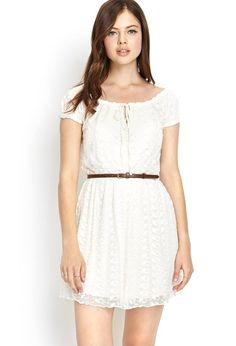 This western-inspired lace dress features a tasseled round neckline with elasticized trim. Comple...