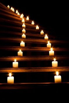 Staircase light up with pillar candles! Hmmm...What a great idea for a romantic night.