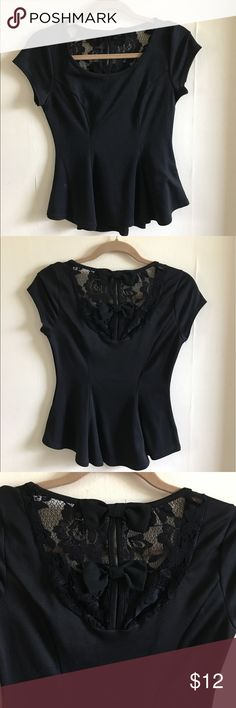 Black Peplum Top Black peplum short sleeve blouse with lace and bow detail in the back. Worn once. Tops Blouses