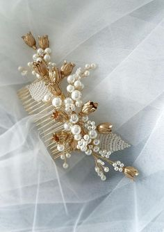 This beautiful handmade bridal hair comb made with pretty crystal elements, gold flowers and ivory glass pearls. Complement most wedding hairstyles. It is the perfect bridal headpiece for that woman who wants to simply sparkle on her wedding day. ♥ Size approx 15 сm x 6 сm (6 x 2.5 ) ♥ Flexible and bendable ♥ ATTACHES: secures easily with the attached large comb ♥ The bridal heapiece will be packed in a gift box ♥ Hand made in our studio NOTE! Processing time 2-4 business days +