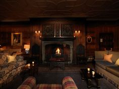 Cozy up to the fire at Gravetye Manor Hotel in England.