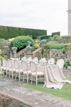 hedsor house spring summer garden wedding reception table with luxury fabric table cloth brocade pattern; french louis guest chairs; erik and ester taper candles on vintage candlesticks; garden flower urns in the background | Photo by London and Newcastle UK based light bright and airy Filipina wedding photographer Cristina Ilao Wedding Top Table, Wedding Reception Tables, Wedding Table Settings, Beautiful Wedding Venues, Elegant Wedding, Hedsor House, Old World Wedding, Summer Garden, Spring Summer