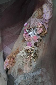 Whimsy very light brooch is inspired by baroque era paintings, primitive doll art, antique laces.. Made of wool-filled cotton and antique lace pieces, silks, embroidery threads..The textiles and cotton are hand painted/dyed, face features stitched and painted with small brush, varnished