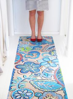 Blogger Alisa Burke painted her hallway floor to look like a runner. Fresh!