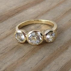 *cough*Mikebuythis*cough*    14k Gold and White Topaz Three Stone or Engagement Ring, Made to Order. $968.00, via Etsy.
