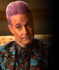 The voice of the Capitol… Stanley Tucci returns as Caesar Flickerman in The Hunger Games: Mockingjay Part 1