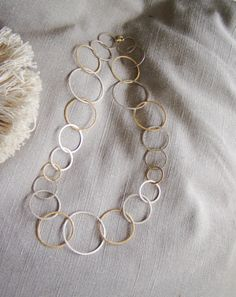 Necklace with silver and gold plated rings by Akatos on Etsy, $125.00