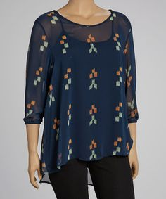Combining a subtle yet stylish pixel-inspired print and a sheer silhouette, this top puts pop in any ensemble. Tuck it into a pencil skirt or throw it on over that favorite pair of jeans and lovely flats.