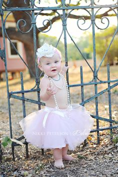 First birthday photo shoot :) topless, tutu, ruffles, lace, bows, pearls, pale pink and of course CAKE!
