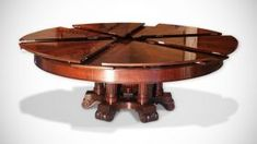 Exquisite table that spins to almost magically transform from small to large. Fletcher Burwell-Taylor Capstan table