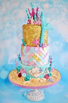 Mermaid birthday cake with gold sequins, corals and shells.