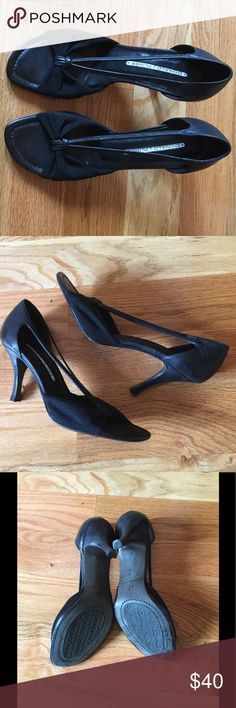 """Donald Pliner black heels with stretchy fabric Donald Pliner black leather heels with stretchy fabric. Worn a few times but still in great condition. Some wear on soles as shown in photos. Does not show when worn. Has 3"""" heel. Donald J. Pliner Shoes Heels"""