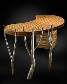 A desk that is also a sculptural art form is designed with a composition that balances the mass of the wood elements with organically shaped steel legs.    Winner: 3rd Place Furniture Design, 2009 ASID Arizona North Chapter Design Excellence Award  Winner: 1st Place Residential Total Remodel, 2008 ASID Arizona North Chapter Design Excellence Award