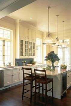Creamy dream kitchen with wood accents.