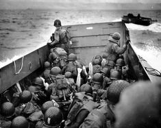 An officer observes Omaha Beach as his landing craft approaches the Norman coast.
