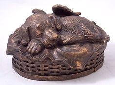 Our Angel Winged Dog Urn is the same as our puppy urn but with more space for larger dogs. This urn is finely detailed throughout and is made of polymer with bronze additive using a traditional cold cast process. The dog, blanket, and basket are bronze. Memorial Urns, Dog Memorial, Pet Cremation Urns, Cremation Jewelry, Dog Urns, Best Dog Breeds, Pet Loss, Sleeping Dogs, Pet Memorials