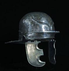 :Roman Bronze or brass helmet of the Weisenau /Nijmegen Type, . 1st century BC – 1st century AD. H. 19cm (+21cm for cheekpieces). Weight 1.3kg.