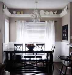 Dining room, shelf over windows, chandelier, black accents