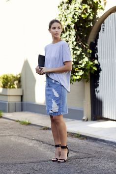 Le Fashion Blog Casual Chic Blogger Style Grey Tee Distressed Denim Skirt Embossed Leather Clutch Black Ankle Strap Heeled Sandals Via Harper & Harley