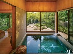 """The large soaking tub, bordered by a *karesansui*, or rock garden, """"is designed for the entire family to bathe together,"""" says the wife"""