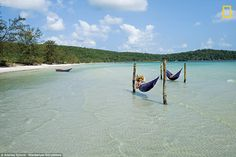 Lazy Beach on Koh Rong Island in Cambodia which has thatched roof huts, crystalline waters, and silky sand beaches which lies in the Gulf of Thailand