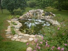 backyard ponds | Backyard Koi pond. like the rocks around the edge..need to do this.