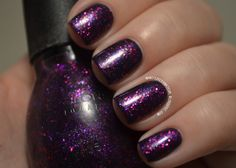 "Sinful Colors ""Stardust"" over Sinful Colors ""Mesmerize""  - Sheer purple with fine and medium glitters in purple and fuschia, over a dark indigo/blurple base."