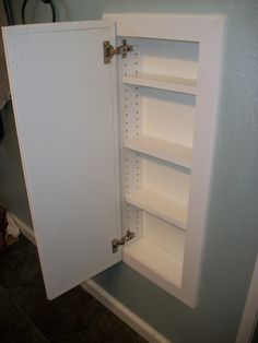 What a Ride!: December DIY Medicine cabinet in between studs in wall What a Ride!: December DIY Medicine cabinet in between studs in wall Wall Cabinet, Diy Medicine, Wall Storage, Wall Storage Diy, Recessed Storage, Diy Cabinets, Small Bathroom, Bathroom Wall Storage, Bathroom Decor