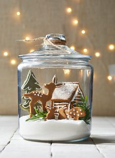 christmas cookies gingerbread Weihnachtspltzchen 4 Clever Ways to Turn Gingerbread Cookies into a Woodland Wonderland Terrarium filled with Gingerbread Cutout cookies, including a reindeer, tree, house, and bunnies Christmas Gingerbread House, Noel Christmas, Christmas Goodies, Christmas Treats, Christmas Decorations, Gingerbread Houses, Xmas, Gingerbread Decorations, Decorating Gingerbread Cookies
