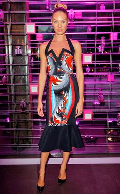 Candice Swanepoel wears a body-hugging printed halter dress with a flared hem by Peter Pilotto.