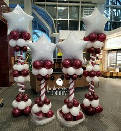Maroon and white star topped balloon columns for a grand opening! | Balloons By Tommy | #balloonsbytommy