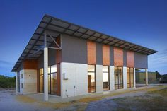 Love the shame and roof of this rammed earth home. Perhaps could fit a loft into such a design?