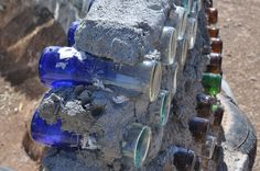 """Bottle Wall """"Art"""" About way between our cabin and Taos, NM lies the Greater World Earthship community. One common design element is the use of """"bottle wal… Natural Building, Green Building, Building A House, Cob Building, Bottle House, Bottle Wall, Use Of Bottle, Cordwood Homes, Earth Bag Homes"""
