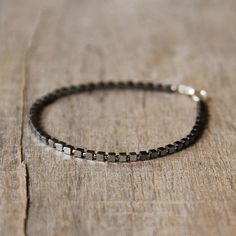 This delicate hematite bracelet features cube hematites in two different shades, tiny Japanese seed beads to separate and underline the beauty of hematites and sterling silver elements oxidized and polished. This soft and stylish bracelet will make a lovely addition to your wardrobe.