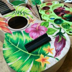 These are ukuleles that I painted for Uke Hub Kafe. I was given freedom to come up with my own designs so I went the tropical=whimsical-wanderlust route. Painted Ukulele, Whimsical, Tropical, Painting, Design, Painting Art, Paintings, Painted Canvas
