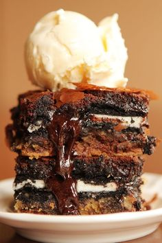 Brownie batter, poured over oreos, arranged over cookie dough, served warm with ice cream on top