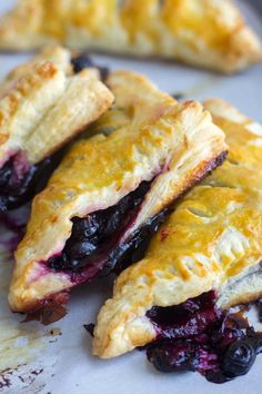 These flaky lemon blueberry turnovers are made with frozen puff pastry so they're easy to make and filled with fresh blueberries and lemon juice.