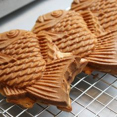 Taiyaki Cakes | Filled with sweet azuki red beans, taiyaki are delicious fish-shaped snacks described as a cross between a waffle and a cake.